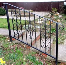 Hand rail with scrollwork